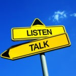 Listen vs Talk - Traffic sign with two options - empathy, unders