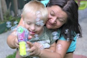 Mum and child playing with bubbles