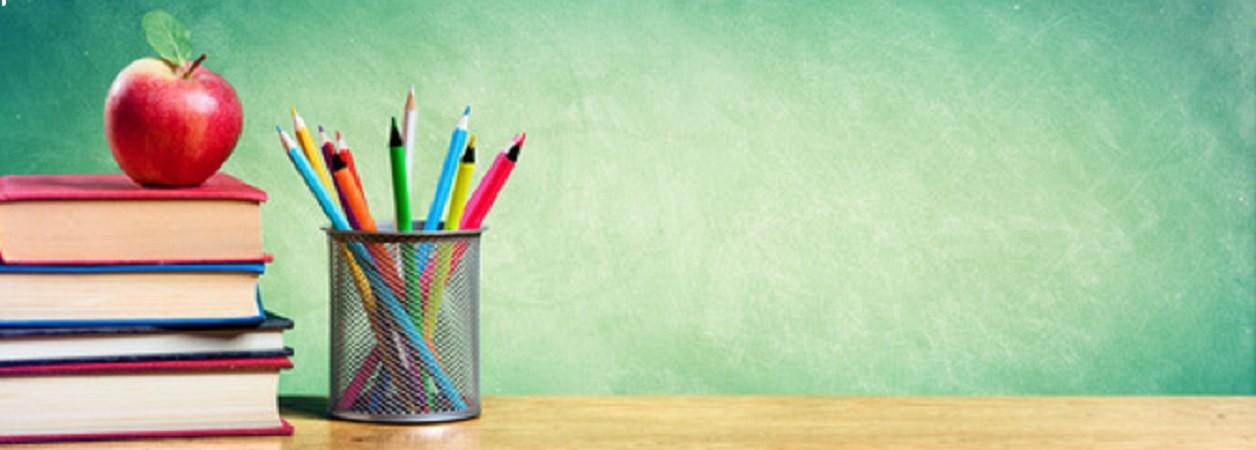 Books, a pot of pencils and a blackboard